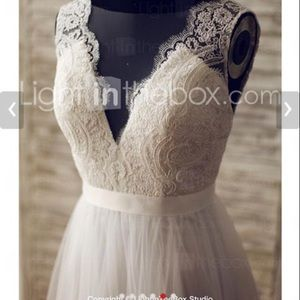 Dresses & Skirts - wedding dress, never worn except to try on.